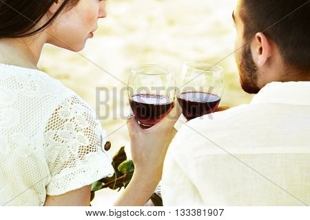 Romantic date of young couple on beach