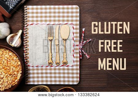 Decorated recipe book with text Gluten Free Menu on wooden background