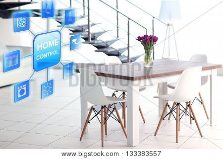 Smart home control concept. Room interior with table and chairs