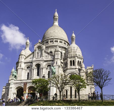 PARIS, FRANCE - MAY 17, 2016: Opened in 1914, Sacre-Coeur Roman Catholic Basilica was dedicated to the Sacred Heart of Jesus. A major tourist attraction, it stands atop a hill in Montmartre, the 18th Arrondissement of Paris.