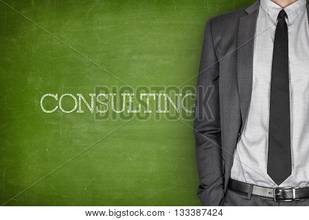 Consulting on blackboard with businessman in a suit on side