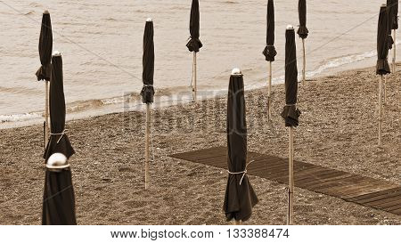 Beach Umbrella on the Sandy Coast near the Italian City of Minori Vintage Style Sepia