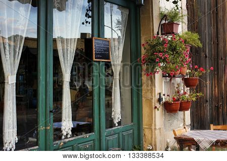 Larnaca Cyprus - May 23 2016: Small Street with cafe in Larnaca during Summer. Cuprus