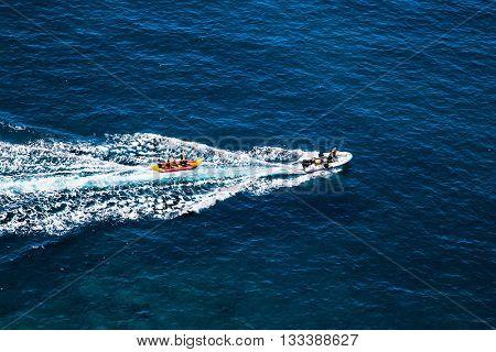 Motor boat Pull Fun Tube on sea in Gran Canaria, Spain.