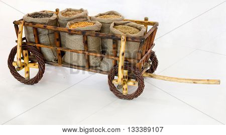Wheelbarrow With Grains In Sacks