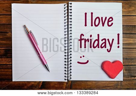 The words I love friday on notebook page