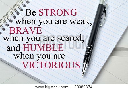 Motivational quote.Be strong when you are weak on notebook