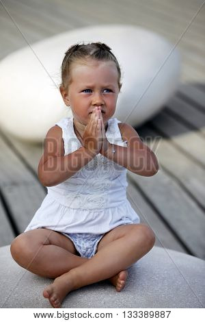 Adorable Little Girl Doing Yoga