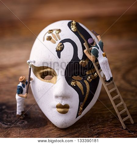 porcelain carnival mask on wood with painters miniature