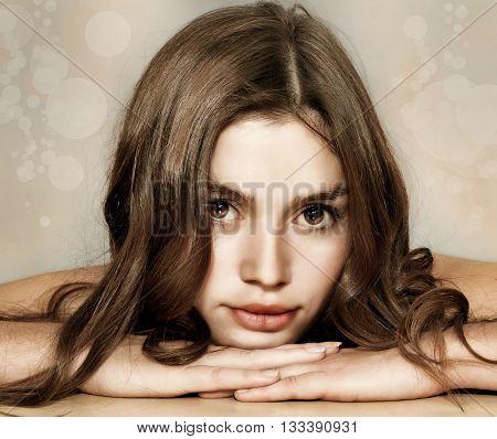 beautiful girl with sensual lips brown hair looking at camera