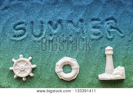 summer written on the blue sand with symbol