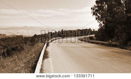 Winding Asphalt Road on Sicily Vintage Style Sepia