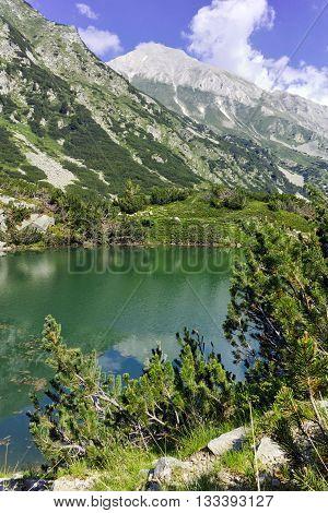 Reflection of Vihren peak in Okoto lake, Pirin Mountain, Bulgaria