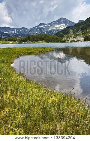 Landscape of Banderishki chukar peak and Reflection in Muratovo lake, Pirin Mountain, Bulgaria
