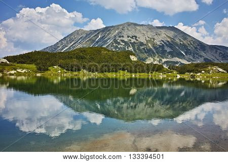 Panoramic view of Todorka peakand Reflection in Muratovo lake, Pirin Mountain, Bulgaria