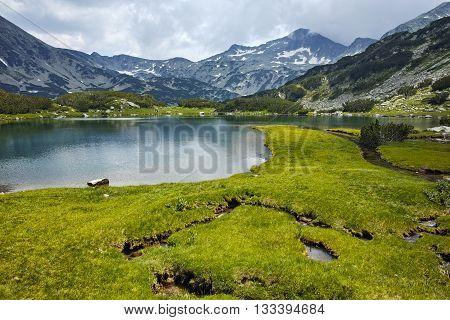 Amazing panorama of Banderishki chukar peak and Reflection in Muratovo lake, Pirin Mountain, Bulgaria