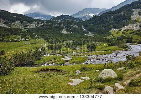 Clouds over Banderishki chukar peak and mountain river, Pirin Mountain, Bulgaria