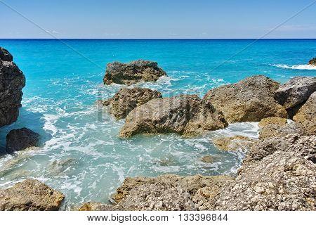 Rocks in the blue waters of Megali Petra Beach, Lefkada, Ionian Islands, Greece