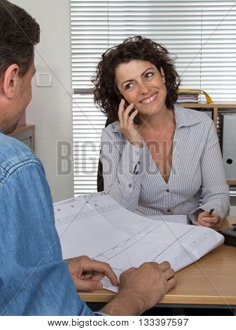Professional Business Woman Receiving Couple Customer In Her Office