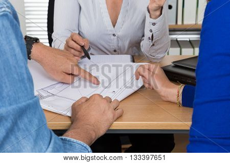Professional business woman receiving a customer in her office