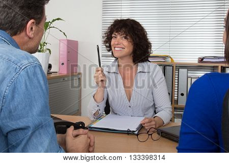 Couple At Meeting With A Banker Female At Desk