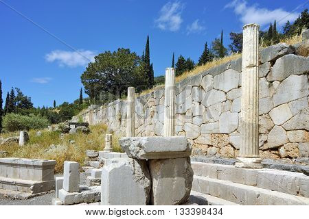 Columns in in Ancient Greek archaeological site of Delphi, Central Greece