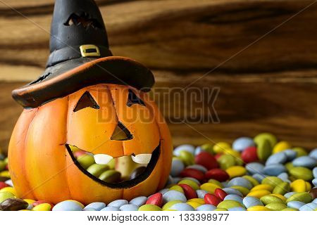 halloween pumpkin with many colored chocolate candy