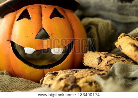 halloween pumpkin with chocolate american cookies and cloth