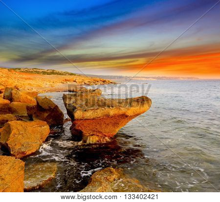 Evening landscape with rocky shore on sea