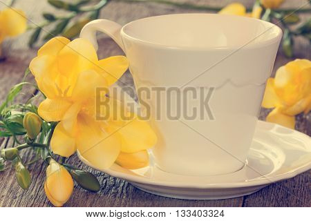 Soft pastel still life with freesia flowers and tea cup