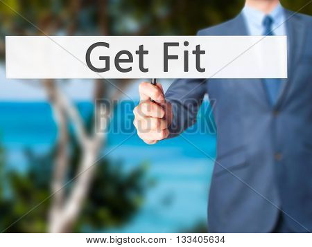 Get Fit - Businessman Hand Holding Sign