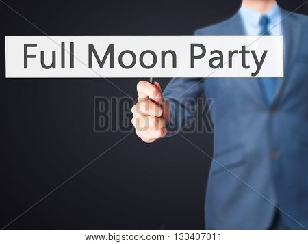 Full Moon Party - Businessman Hand Holding Sign