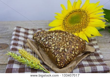 Fresh bread. Pieces of bread with sunflower seeds. Loaf of wholemeal bread