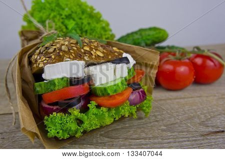 sandwich with cheese, lettuce, cucumber and tomato