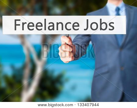 Freelance Jobs - Businessman Hand Holding Sign