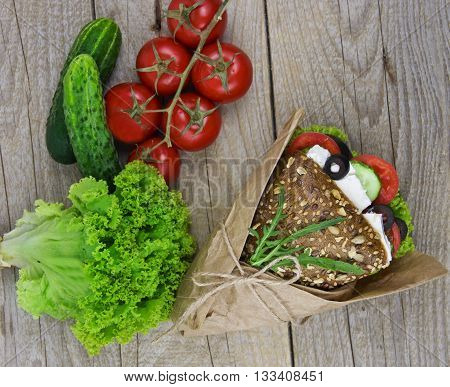 sandwich with salad ham cheese and tomatoes on wooden table. Top view with copy space
