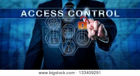 Caucasian manager is pushing ACCESS CONTROL on an interactive touch screen interface. Physical and information security concept for selective and authorized permission to access resources or places.