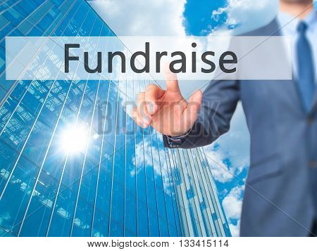 Fundraise - Businessman Hand Pressing Button On Touch Screen Interface.