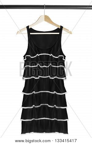 Black cocktail dress on wooden clothes rack isolated over white