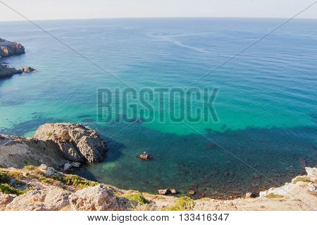 rocky sea lagoon and sea receding into the distance
