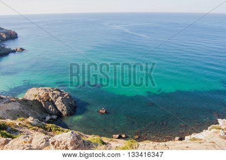 rocky sea lagoon and sea receding into the distance