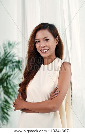 Portrait of lovely Asian woman smiling and looking at camera