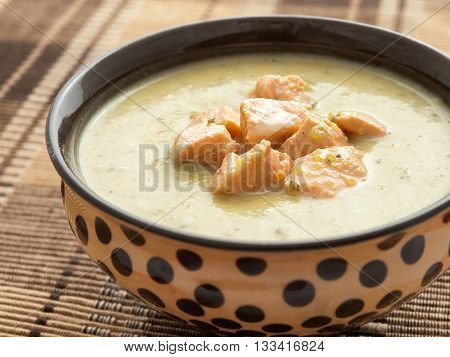 Healthy vegetables cream soup with chicken blocks and cream shot from above horizontal shot