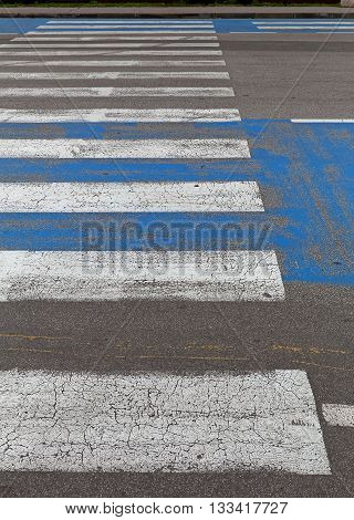 A Pedestrian Crossing Zebra Crosswalk at Street