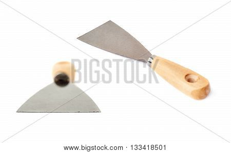 Set of Putty kniFe with wooden handle over isolated white background