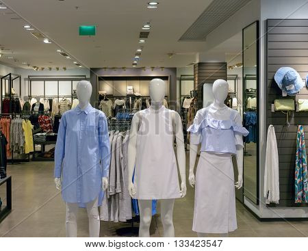 Moscow, Russia - March 29, 2016: Three plastic mannequins in clothes store of the shopping and entertainment center