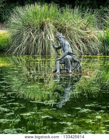 Statue of Neptune in Motcombe Park Eastbourne East Sussex UK.