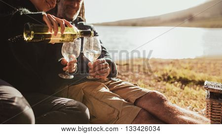 Couple Enjoying Wine On Camping Trip