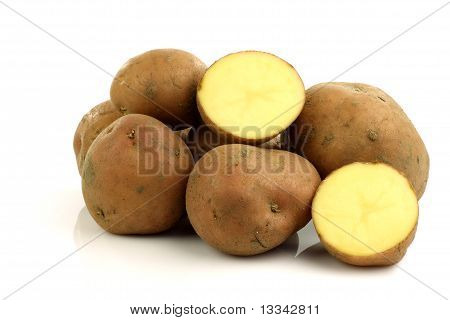 Bunch of potatoes and a cut one