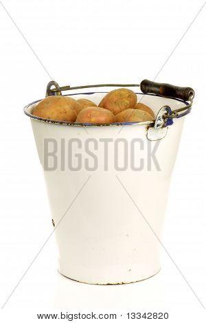 Bunch of potatoes in an old enamel bucket